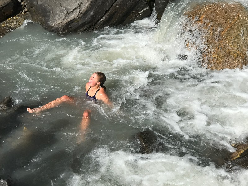 Elsa experiencing the chill of glacier water