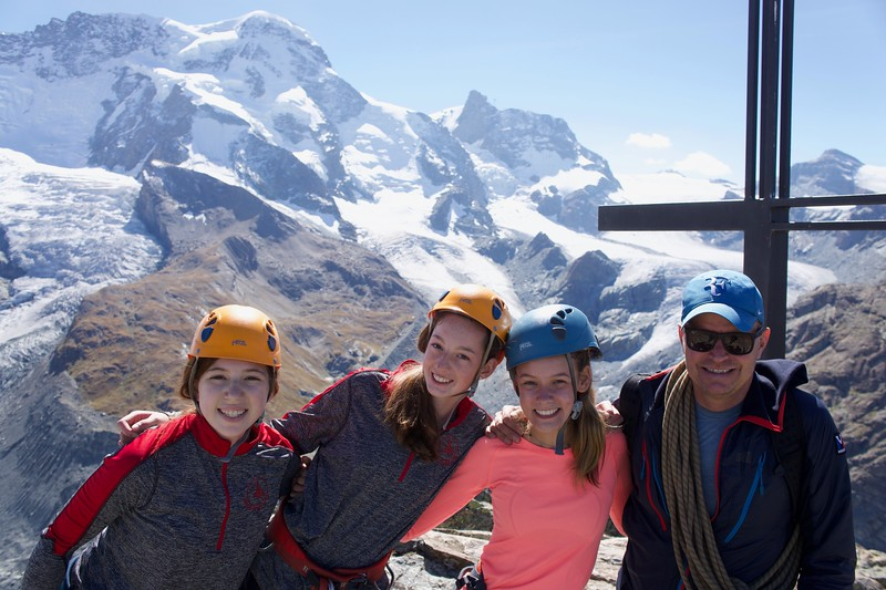 Emily, Charlotte, Lauren, and Guide Andy at the top of Riffelhorn