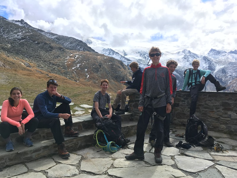 Caroline, Ridley, Josh, Luke, Edward, Hayes, and Ryan stopping at Tasch Hut on the way down from Alphubel