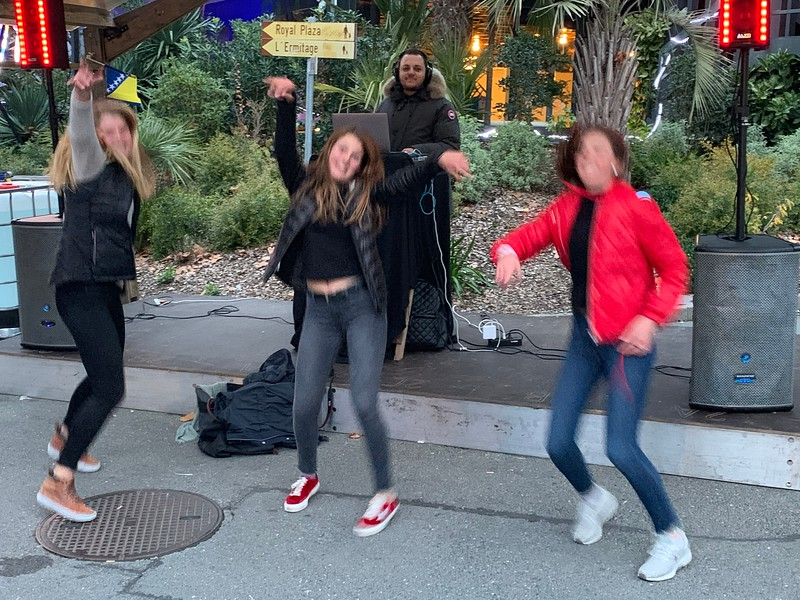 Elsa, Kate, and Ava dancing at the Montreux market