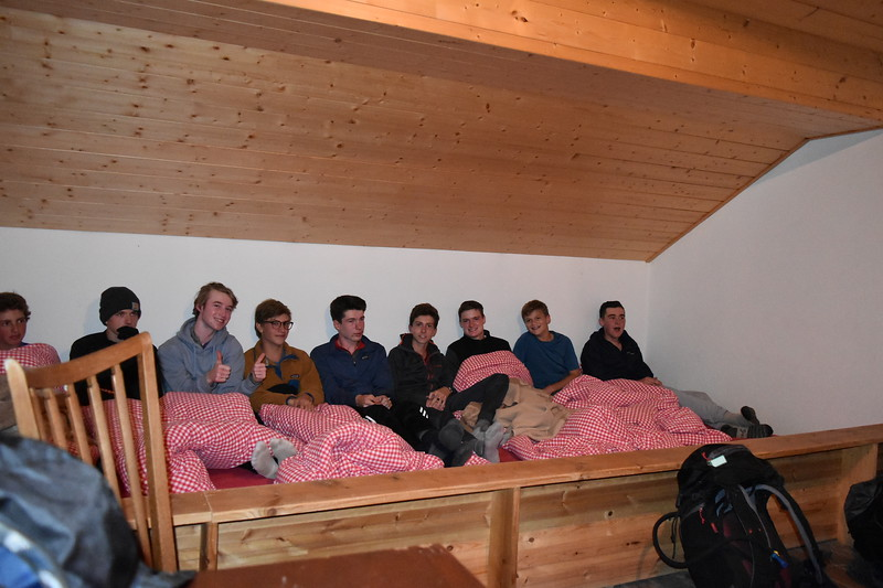 Hayes, Thomas, Layton, Gardiner, Riley, Will, Matt, Ryan, and Vince getting ready to listen to the story of the first ascent of the Matterhorn