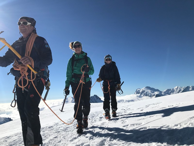 Swiss Guide with Bella and Terra at the summit of Alphubel