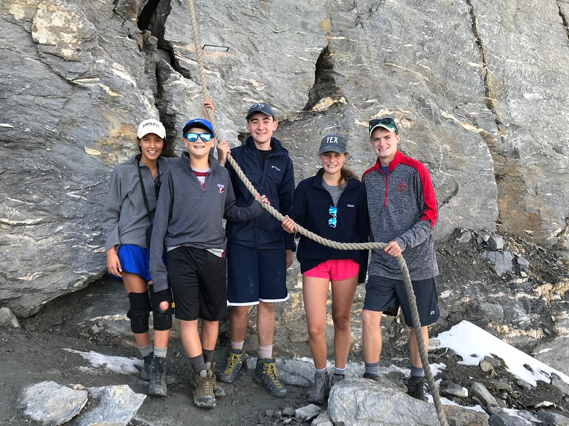 Elina, Ryan, Vince, Kate, and Matt at the base of the Matterhorn holding the rope that starts the ascent of the mountain