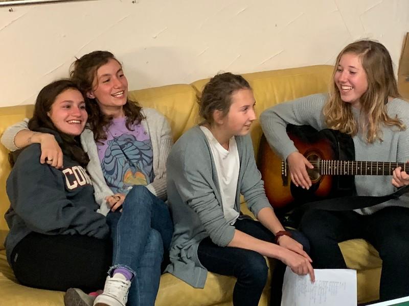 Mia, Sophia, Mia, and Emerson singing in the study hall area