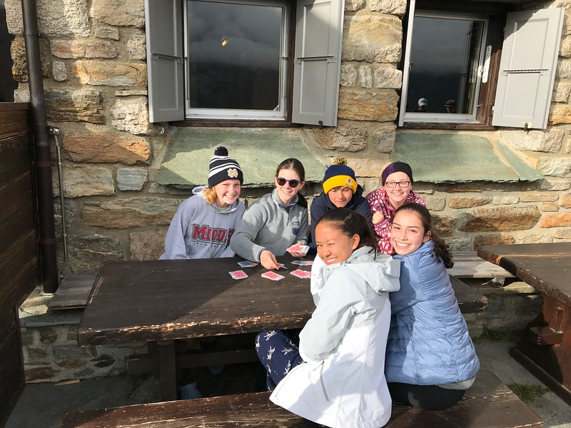 Arriving at the Täsch hut and playing some cards before dinner (Ellie, Aisling, Allison, Michael, Amanda, and Caroline)