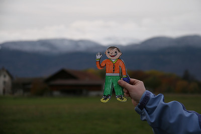 Flat Stanley in front of a Swiss farm