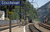 Goschenen station, Tues 4 July 2006 3.  A northbound train starts the steep descent to Erstfeld - 18 miles at 1 in 40 or slightly more.  In this distance the line climbs just over 2000 feet by means of one spiral and two semi-spiral tunnels.  There are no fewer than four spirals on the southern approach to the St Gotthard tunnel from Bellinzola.