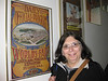 Mom posing with the St. Louis World's Fair poster at the hotel in Lausanne - Olympic Capitol