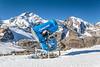 A snow making machine in the Bernina mountain peaks and the Diavolezza Glacier near St. Moritz, Switzerland, Europe.