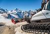 A ski run grooming machine in the Bernina mountain peaks and the Diavolezza Glacier near St. Moritz, Switzerland, Europe.