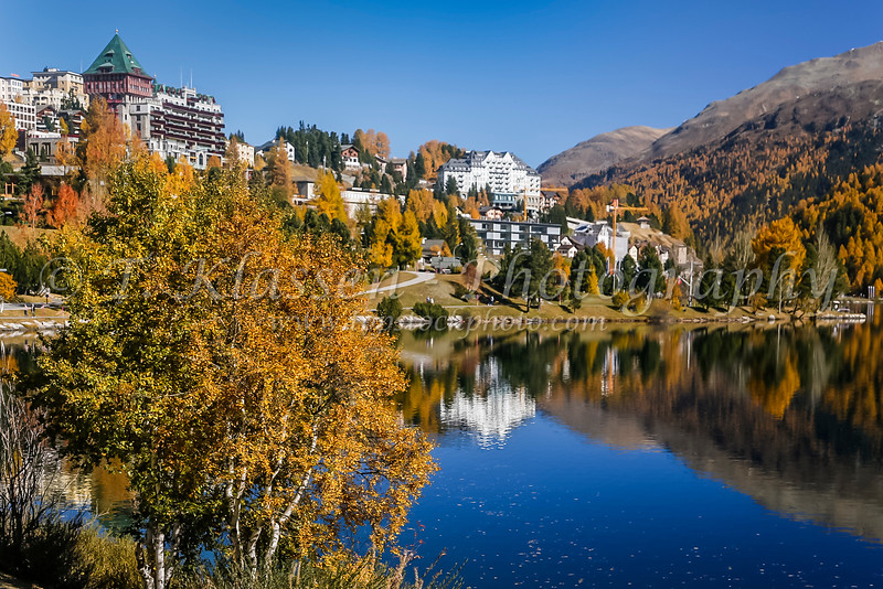Fall foliage color and the luxury resort town of St. Moritz, Switzerland, Europe.