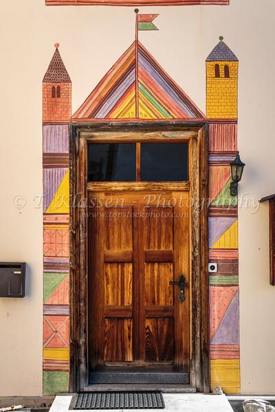 A front entrance door in the village of Fuldera, Switzerland, Europe.