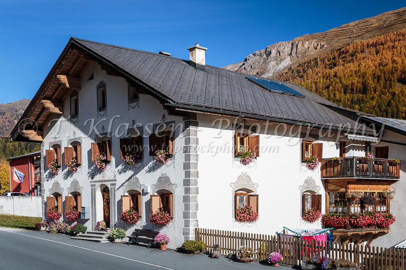 A typical Swiss cottage architecture in the village of Fuldera, Switzerland, Europe.