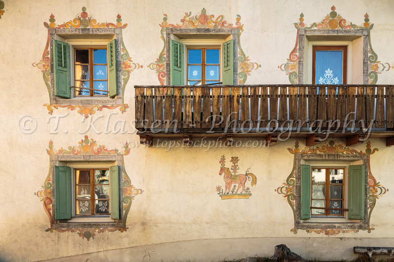 Ornate window designs in the village of Fuldera, Switzerland, Europe.