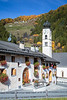 The church steeple and fall foliage color in the village of Valchava, Val Muestair, Switzerland, Europe.
