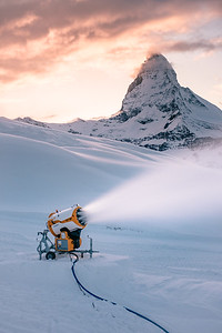A snow cannon near the Matterhorn at sunset