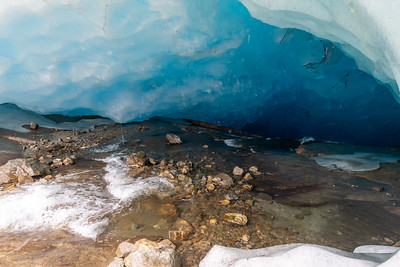 A hole under the Aletsch glacier into which a stream rushes.