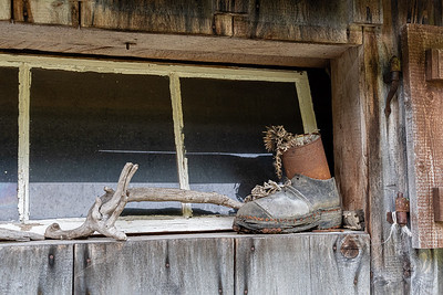 Scene in the window of a weathered summer-pasture cottage, above Amden Switzerland.