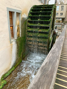 A water wheel powers the paper mill at the paper museum in Basel.
