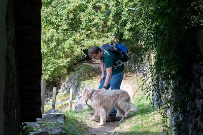 Andy greets a neighborhood dog on a trail in Monte Carasso, near Bellinzona, Switzerland.