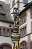 Statue of a warrior in battle dress (c 1600), atop a medieval fountain by the Basel State Archives, Old Basel, Switzerland
