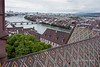 View of the Danube River and Basel city across the tile roof of the Basel Munster in Old Basel, Switzerland.