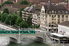 Tram crossing the Mittlere Bridge across the Danube River towards Klein Basel, Old Basel, Switzerland (best larger)