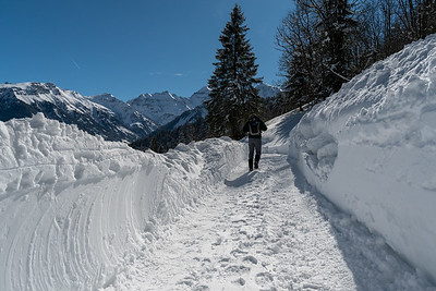 Andy passes through a cleared section of road that had been covered by a small avalanche.
