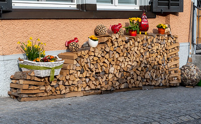 A decorative firewood pile on the streets of Schwanden.