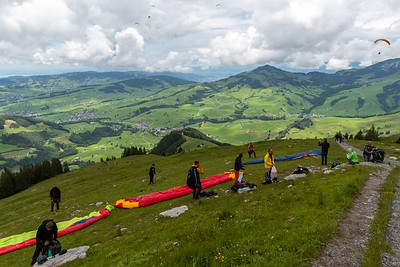 Paragliders launch from Ebenalp, Appenzell.