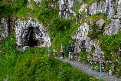 Pam and Andy walk into the caves between Ebenalp and Aescher, Appenzell.