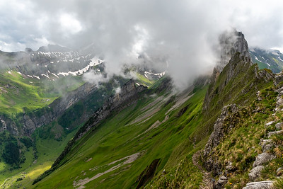 The trail from Schäfler up the valley follows a jagged 'knife-edge' trail, with cable handrails and slippery footing.