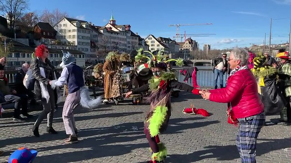 Zurich fasnacht musicians dance to the music of another fasnacht band.