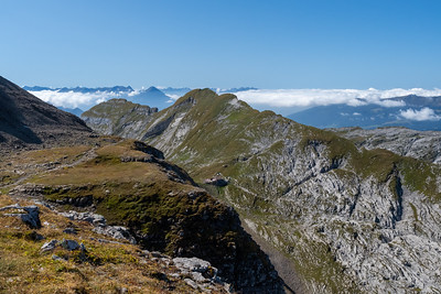 A look back along the trail at left, down at the Berghaus Männdlenen at center.