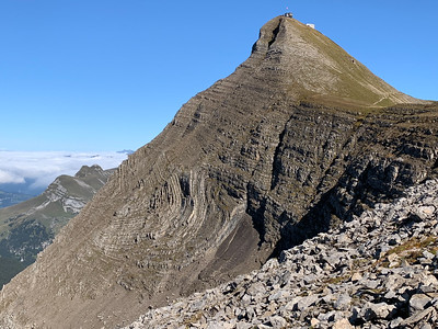 The geology of Faulhorn peak involves impressively folded sedimentary layers.