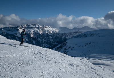 A skier takes in the view from the 2222m summit of Flumserberg.