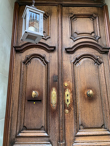 An interesting door in Fribourg, with a reflection of the Cathedral in its lantern.