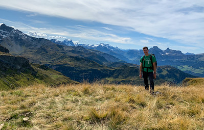 David near the Berglimattsee lake and the pass over a shoulder of Gandstock, Switzerland.