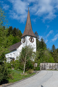 The church in Fischenthal tolls the bell for Sunday services.