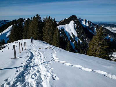 Descending the ridge from Kronberg summit; heading for that hut just left of the central green hilltop.