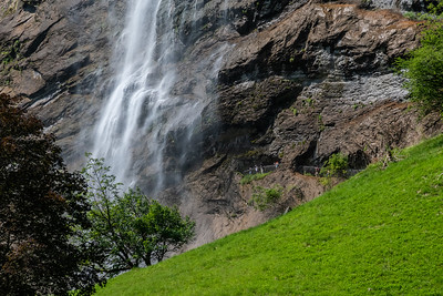 People walk to the base of Staubbach falls, in Lauterbrunnen.