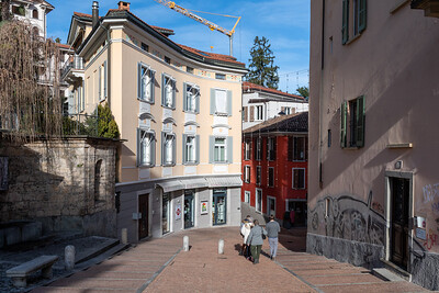 A building curves to match the street, in Lugano.