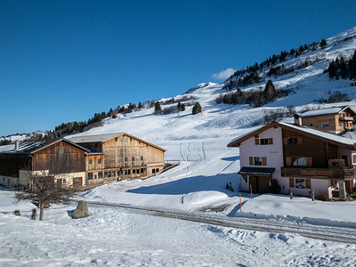 Ski directly off the slope, through the village, past the cow barn, to the restaurant in Miraniga, Switzerland.
