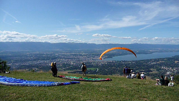 Saleve, France.  Paragliders taking off. You can rise up on air thermals and/or use wind pushed straight up from the cliffs below like these guys.  You can float for hours before descending down to the valley.  hundreds and hundreds of locations to fly from in Switzerland.  Incredible.