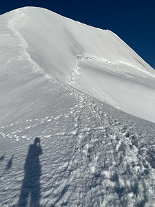 View up to the east peak of Piz Palü, from the saddle on its shoulder.