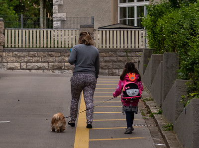 Mom and child off to school.