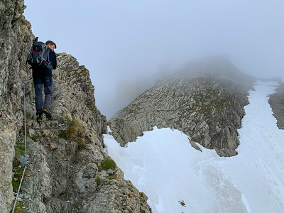 Crossing the Lisengrat ridge, with the summit of Säntis barely visible in the mist ahead.