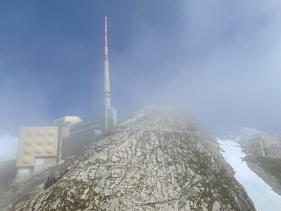 The Säntis summit starts to shake loose its cloud cover.