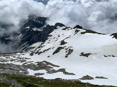 Looking back at the Lisengrat ridge (right), with Altmann summit visible through clouds at left, and Rotsteinpass below it.