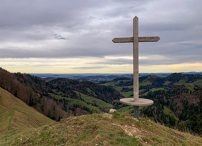 Summit of Hirzegg, with a cross that doubles as a seat.